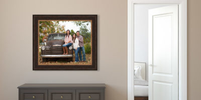 Framed family portrait hanging in a modern home.