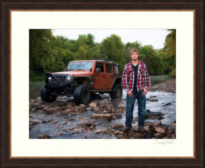 Guy with his jeep in a river - senior portrait
