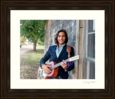 Framed senior portrait of a guy with his guitar made near Fulshear, Tx by Senior Photographer Sandy Flint