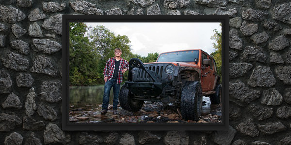 Senior portrait of a guy with his jeep in a river by Sandy Flint | Flint Photography