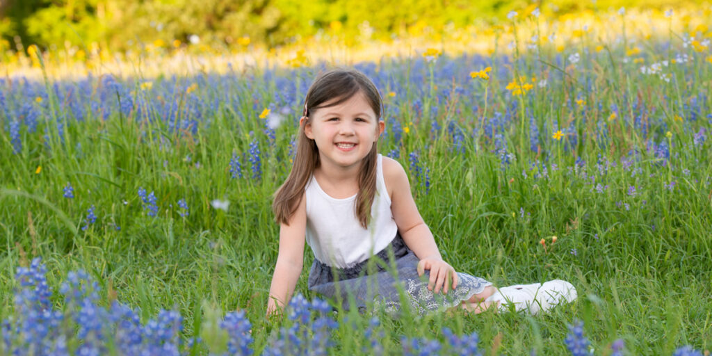 Child's portrait in Texas Bluebonnets made near Katy, TX
